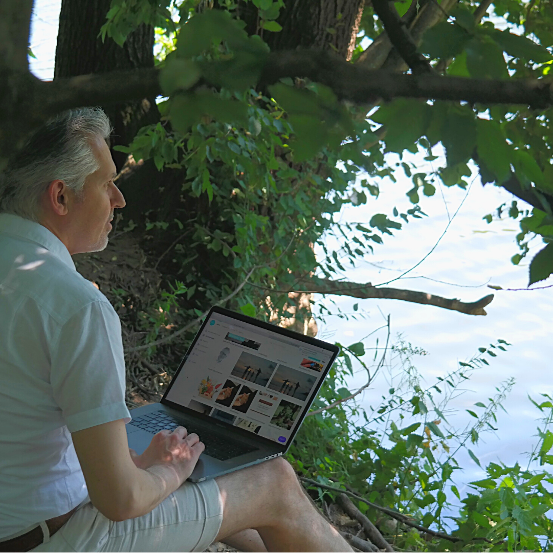 Laptop by river